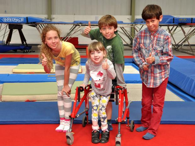 Thomas, Alex and Emily with Jessica Avery as they raise money to help Jessica walk unaided.