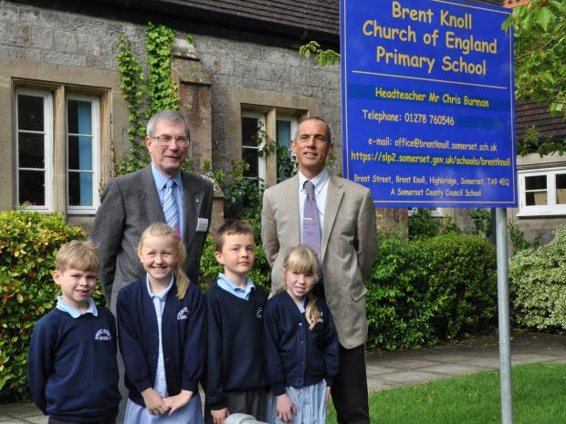 Pupils Jaspar, Megan, Darragh and Lucy with chair of governors Hugh McKay (left) and new head teacher Chris Burman.