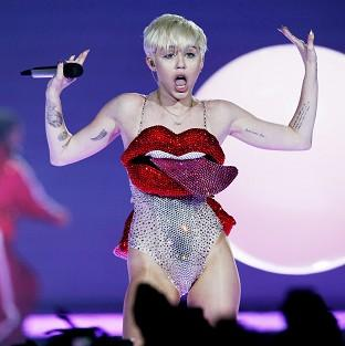 Miley Cyrus has denied she told a vomiting Jennifer Lawrence to pull herself together