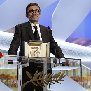 Director Nuri Bilge Ceylan accepts the Palme d'Or award for his film Winter Sleep (AP)