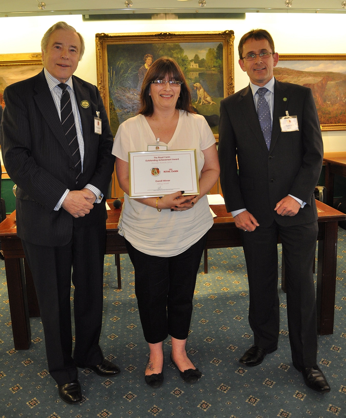 Sally Wood, centre, is pictured collecting her award from Kennel