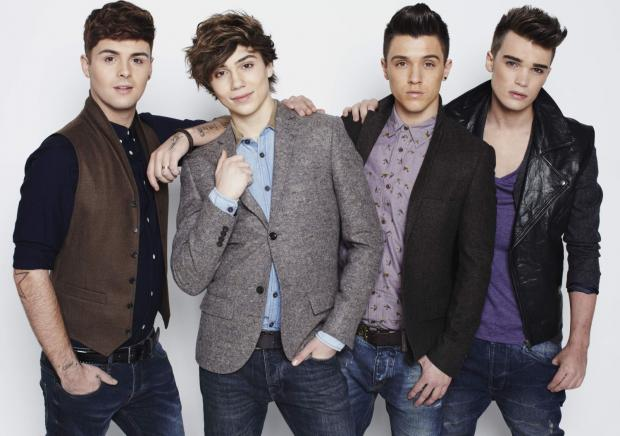 George Shelley (second from the right) with band members