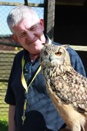 Volunteer Greg with Mumbles the owl