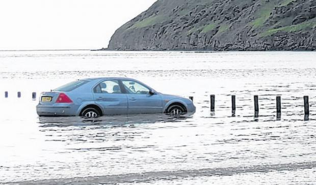 ONE of the cars which became stranded on Brean beach on Monday evening. Photo: Burnham-On-Sea.com