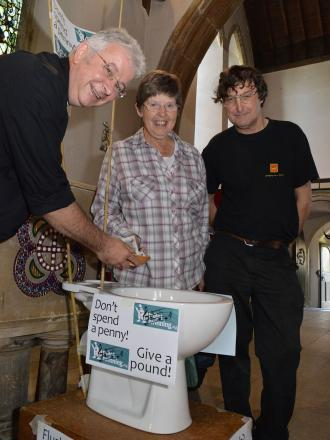 The Rev Simon Bale, organise Pauline Chadwick and sound engineer Clive Bond at the collecting 'bowl'.