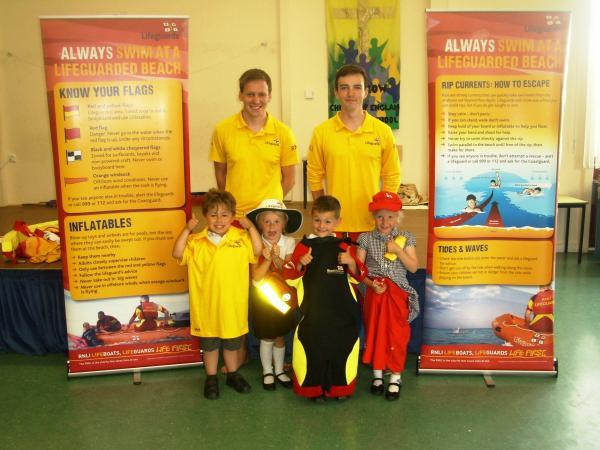 Burnham and Highbridge Weekly News: Lifeguards talk to children from Berrow Church of England Primary School. Photo: RNLI.