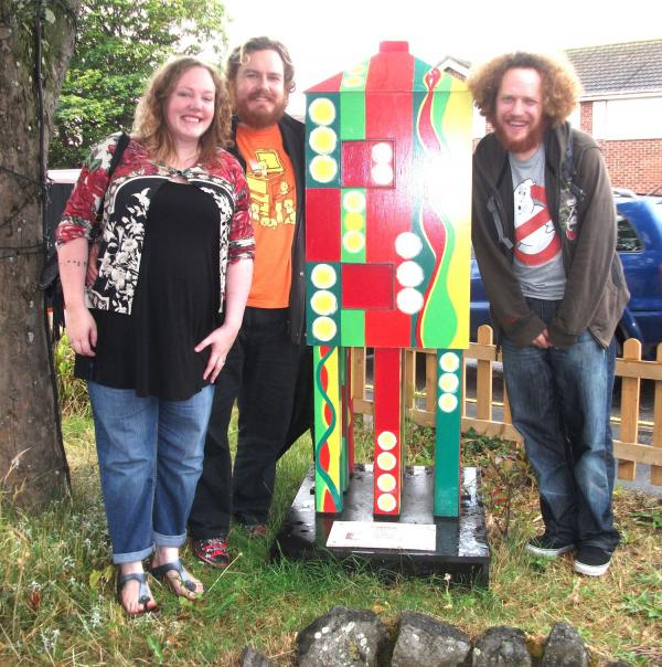 ARTIST Susan Hammond-Lovatt's family, Lily, Ben and Danny, pictured with a hand-painted lighthouse. PHOTO: Susan Hammond-Lovatt.