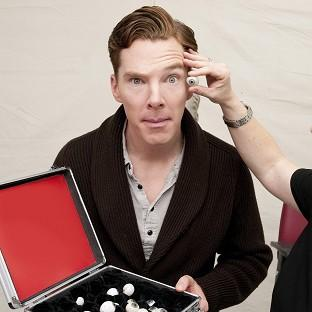 Sherlock actor Benedict Cumberbatch is measured up for his wax figure