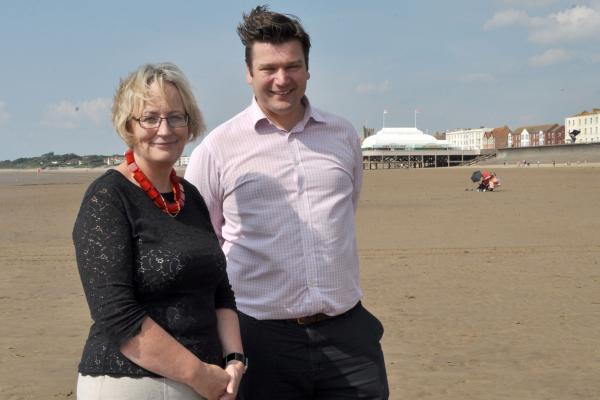 ames Heappey with Julie Girling on Burnham's beach. Photo: Mike Lang.
