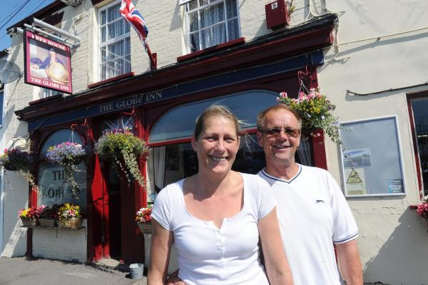 MARGARET Day and Des Griffiths outside their pub, The Globe.