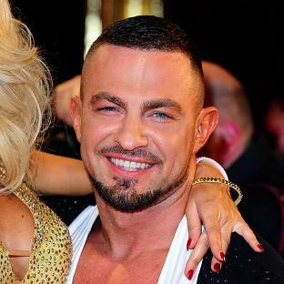 Strictly Come Dancing pro Robin Windsor has pulled out of this year's show as a result of a back injury