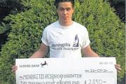 SELFLESS Ben Stacey with the charity cheque for £2,850, which includes £1,000 of his own money.