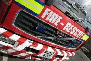 Chimney fire on a thatched building in Axebridge