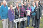 CLLR Martin Cox hands over the Mayor's Awards to residents in Trinity Close. Photo: www.burnham-on-sea.com