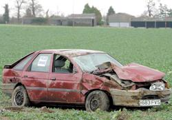 Burnham and Highbridge Weekly News: Wrecked - a car in a field beside the A120 between Wix and Ramsey. Picture: TERRY WEEDEN (53807-1)