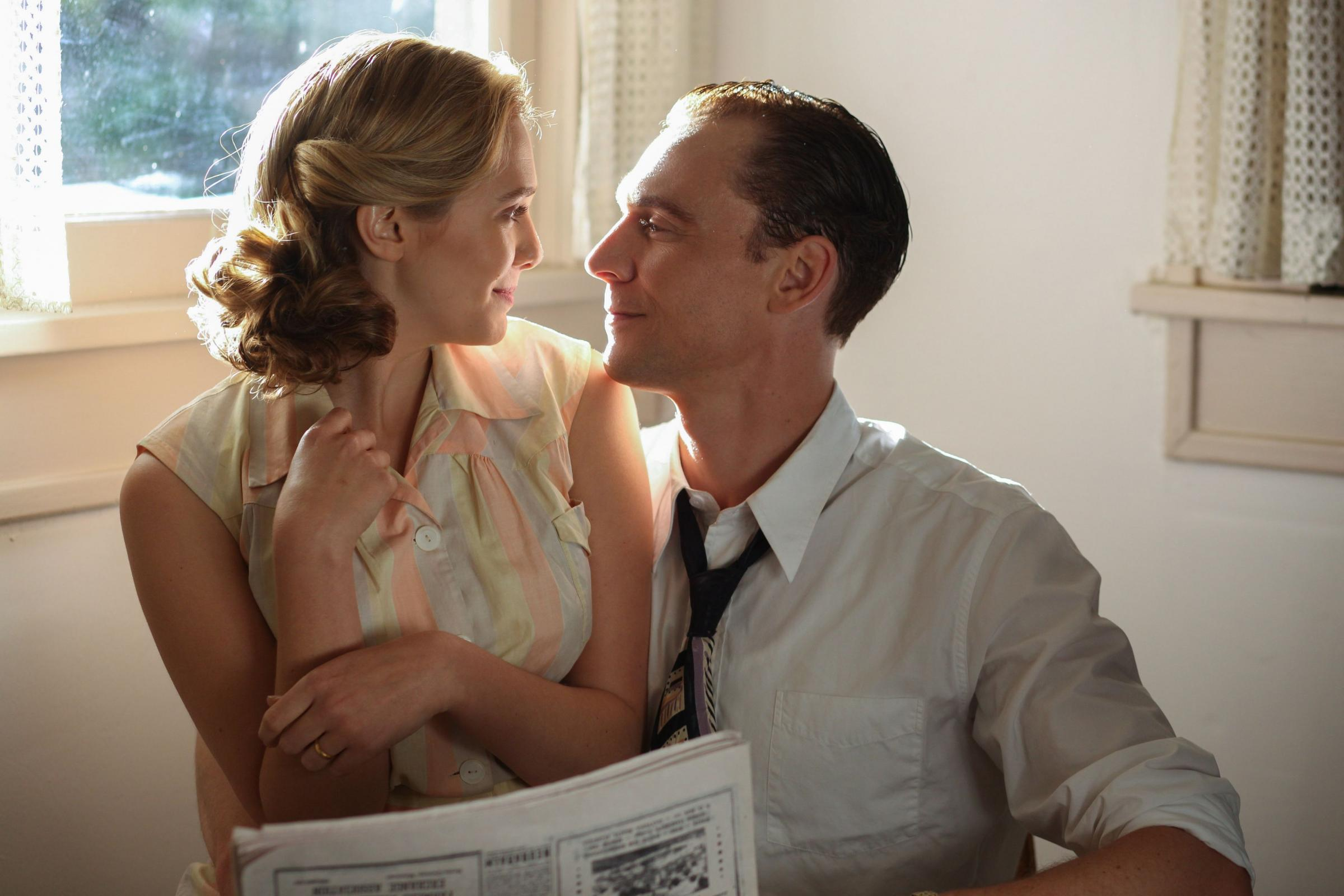 FIRST LOVE: Elizabeth Olsen as Audrey Williams and Tom Hiddleston as Hank Williams