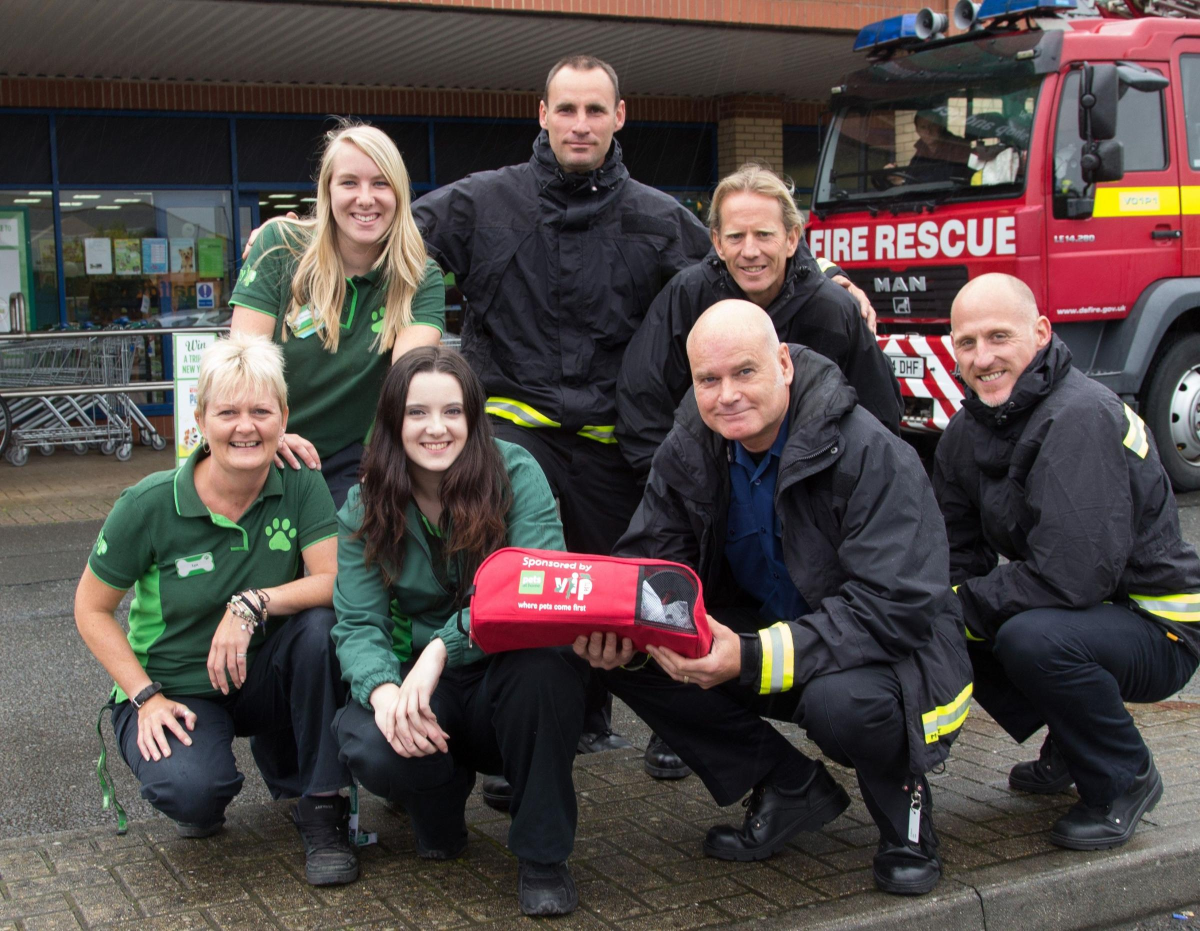SAVING FURRY LIVES: Pets at Home staff and members of the Devon and Somerset Fire and Resue Service at the handover of the 'Smokey Paws' breathing equipment in Barnstaple.