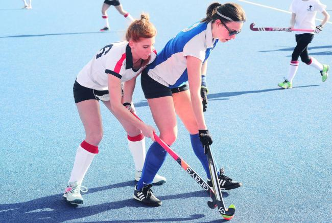 BRACE: Hattie Lambourne (pictured in blue) scored twice against Taunton Civil Service. Pic: Steve Richardson