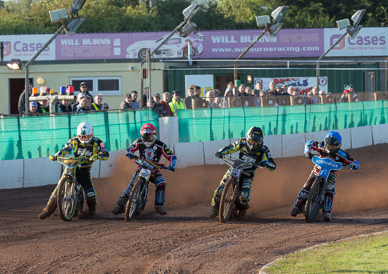 AROUND THE BEND: The riders head into the first corner during last Friday's defeat against King's Lynn. Pic: Colin Burnett