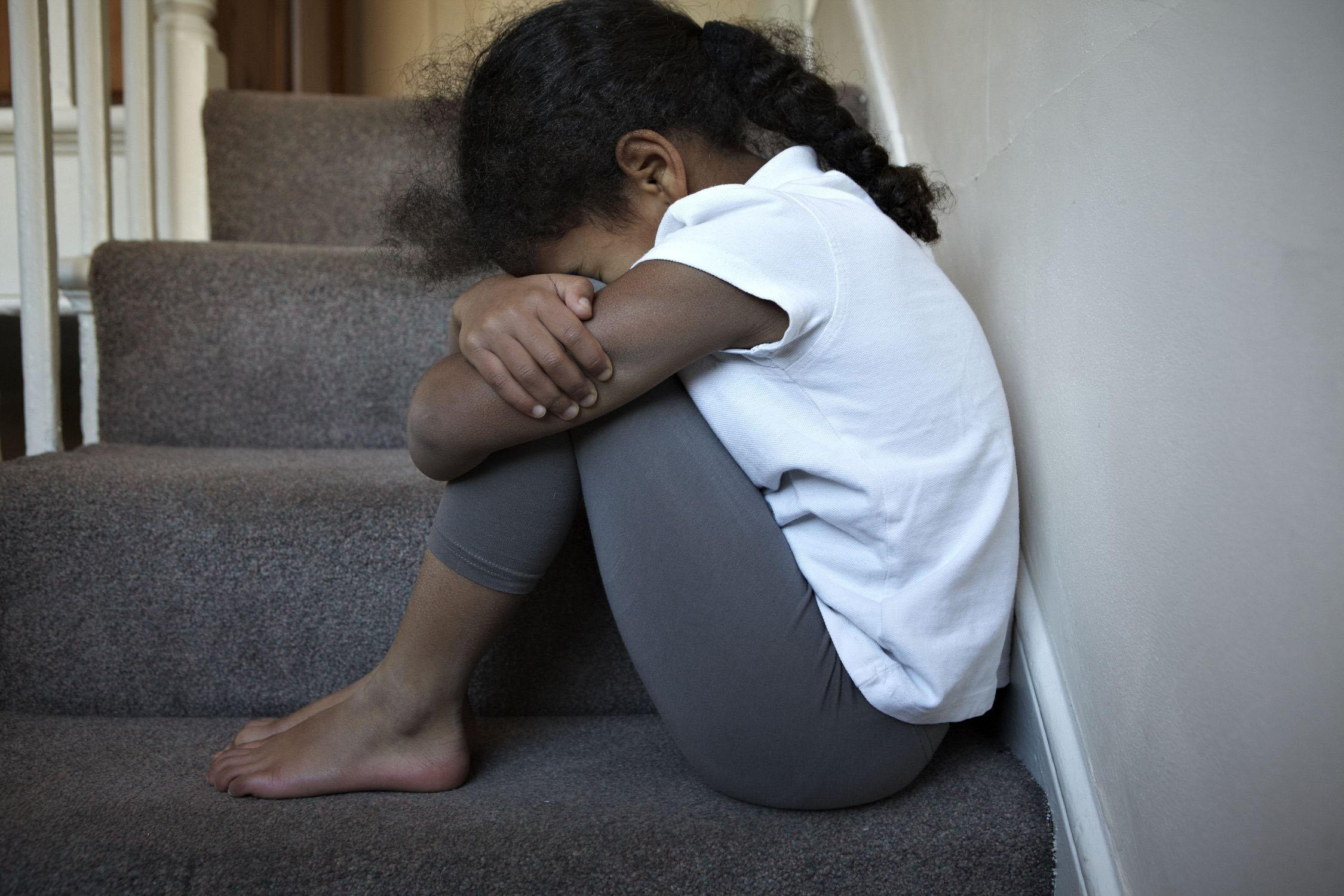 Embargoed to 0001 Tuesday September 26..NOTE: PICTURE POSED BY MODEL. Undated handout photo posed by a model issued by the NSPCC of a child sitting on some stairs. Around 1.2 million children who have suffered abuse are being let down by mental health ser