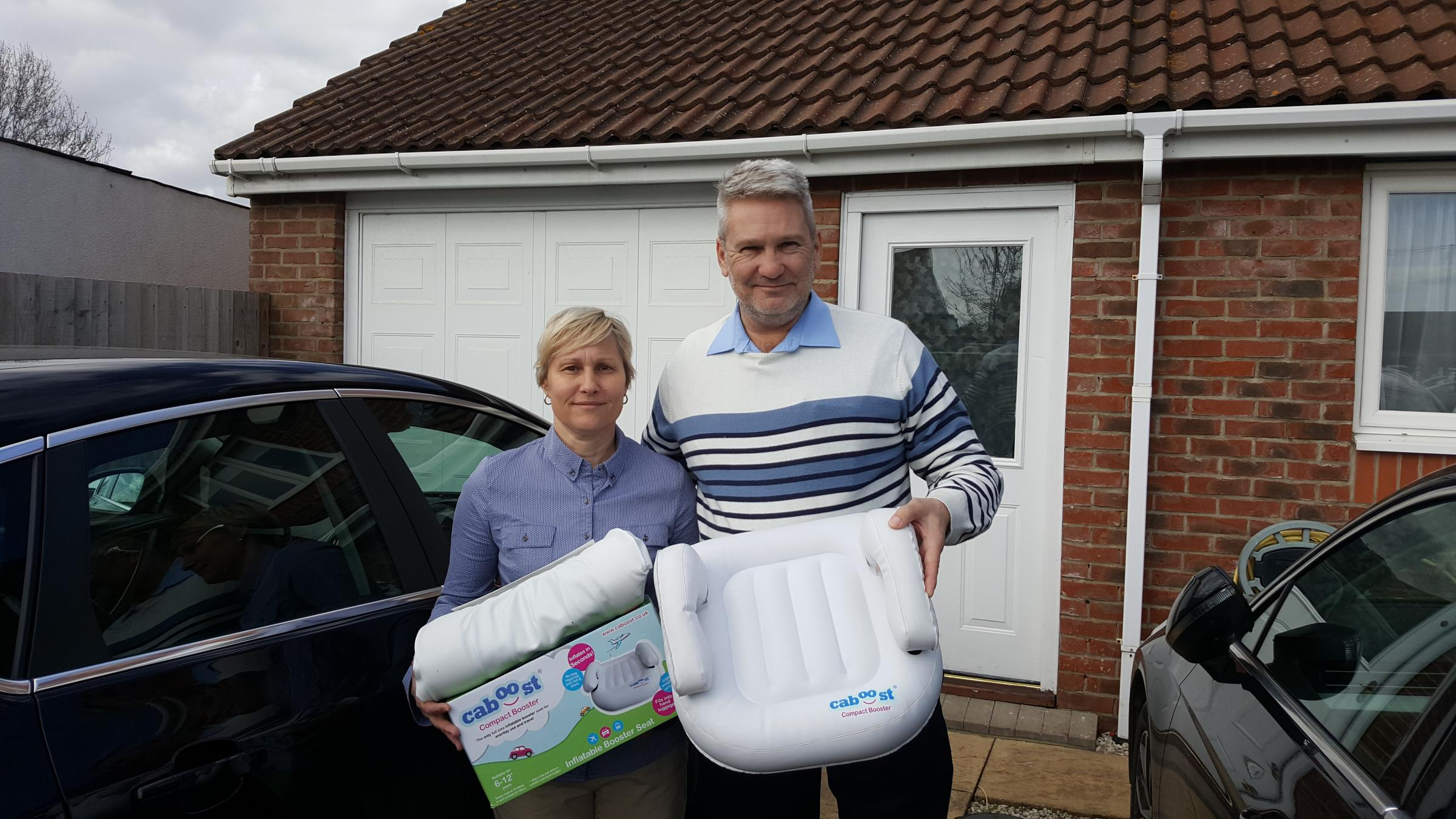 NEW VENTURE: Sue Spaven and her husband Steve with the Caboost car seat