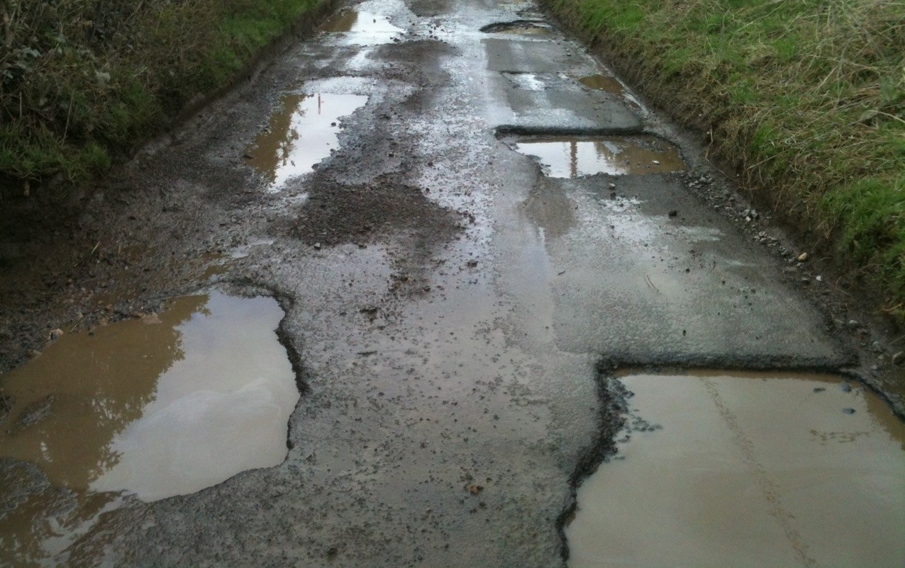 DANGEROUS: Whitelackington Road is full of deep and deadly potholes