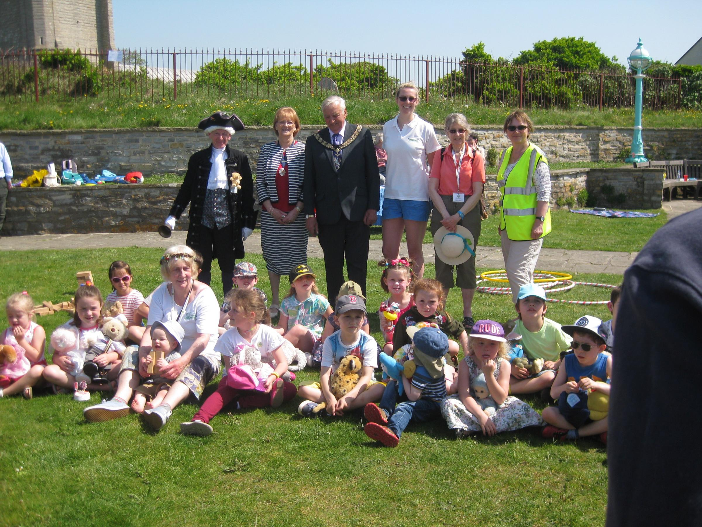 FUN IN THE SUN: The Mayor of Burnham-on-Sea Cllr Bill Hancock and The Friends of Marine Cove Gardens smile with visitors in the sunshine