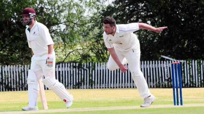 CHARGING IN: Huntspill & District's CJ Organ in bowling action against Ilton. Pic: Steve Richardson