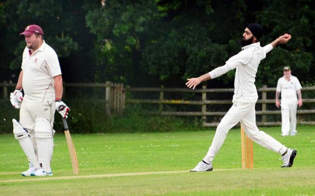 BOWL: Sunny Singh in action for East Huntspill's West Somerset League side against North Curry. Pic: Steve Richardson