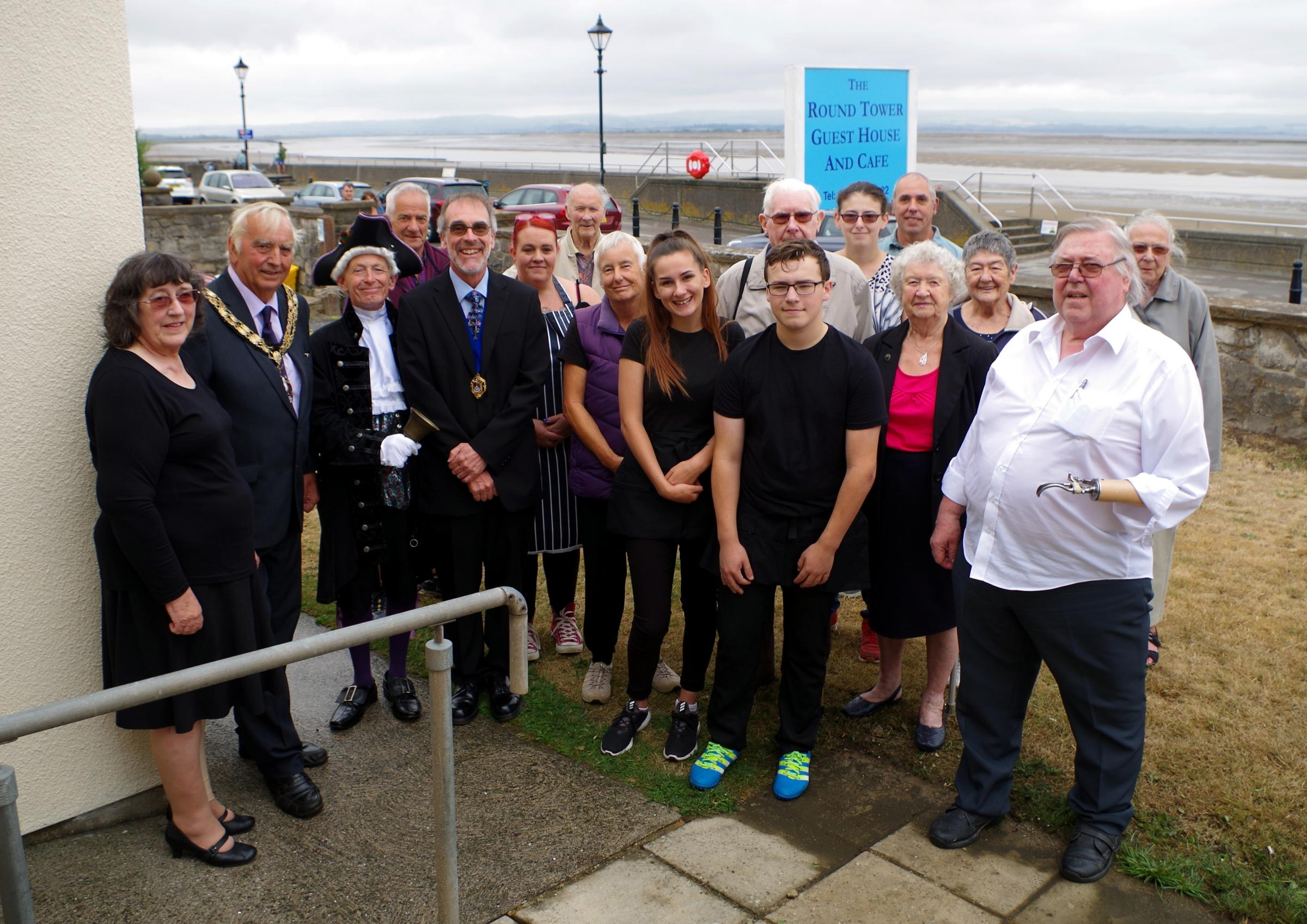 OPEN: Pheobe Pearce and Stuart Pearce, owners of The Round Tower Guest House with Cllr Bill Hancock, mayor of Burnham and HIghbridge and residents at tbe cafe opening