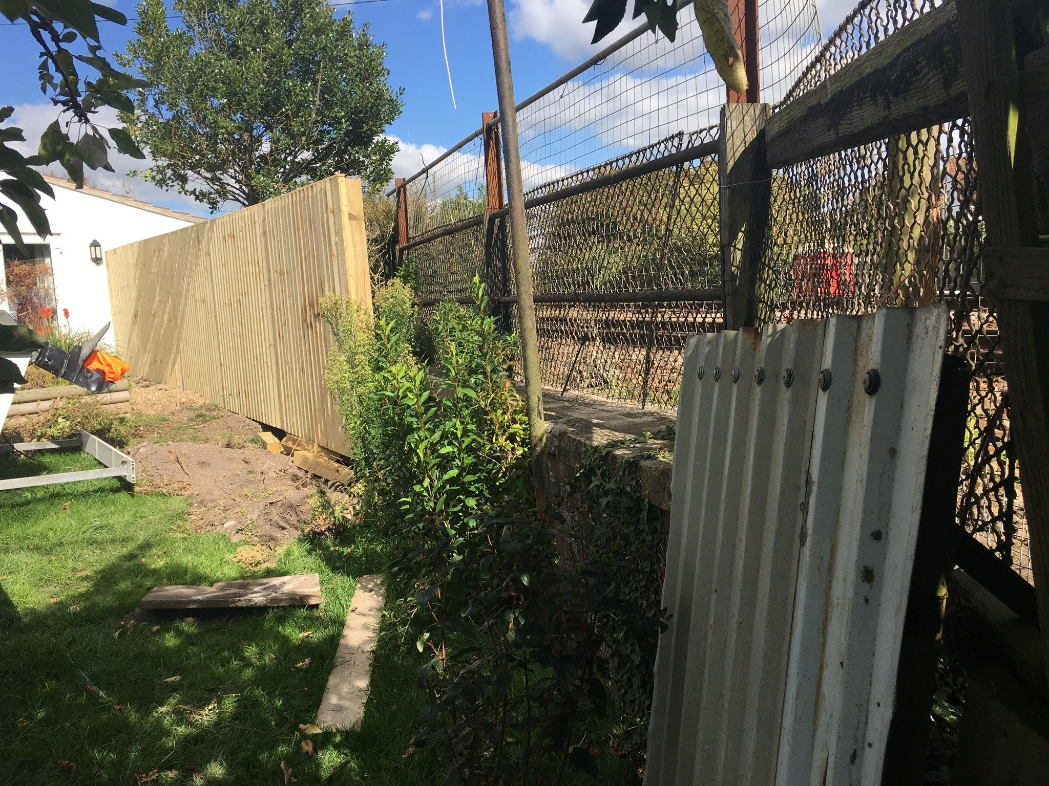 PROBLEMS: The temporary fence which separates Amanda Close's property from a busy railway line in West Huntspill