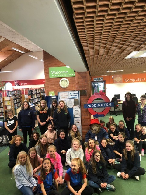 SLEEPOVER: Brent Knoll Guides with staff at Burnham-on-Sea Library