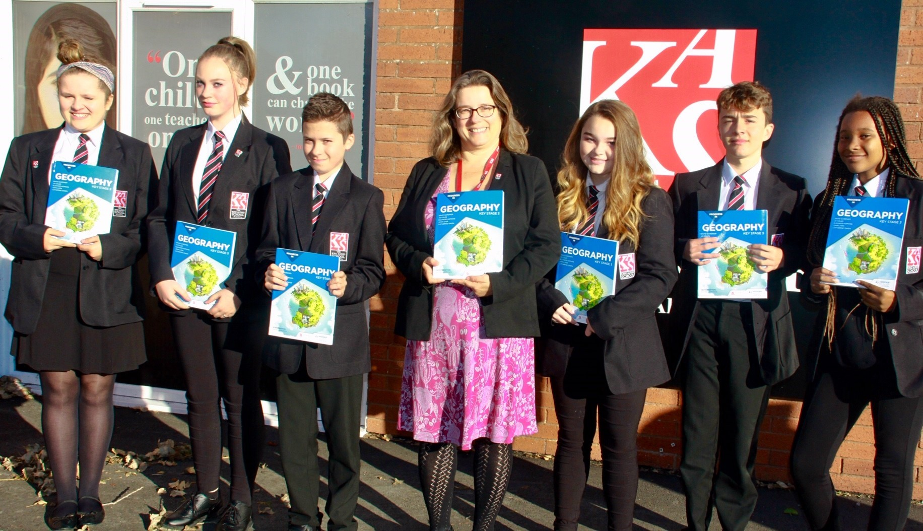 CELEBRATING: Catherine Owen, head of Geography at The King Alfred School and her students with her new book