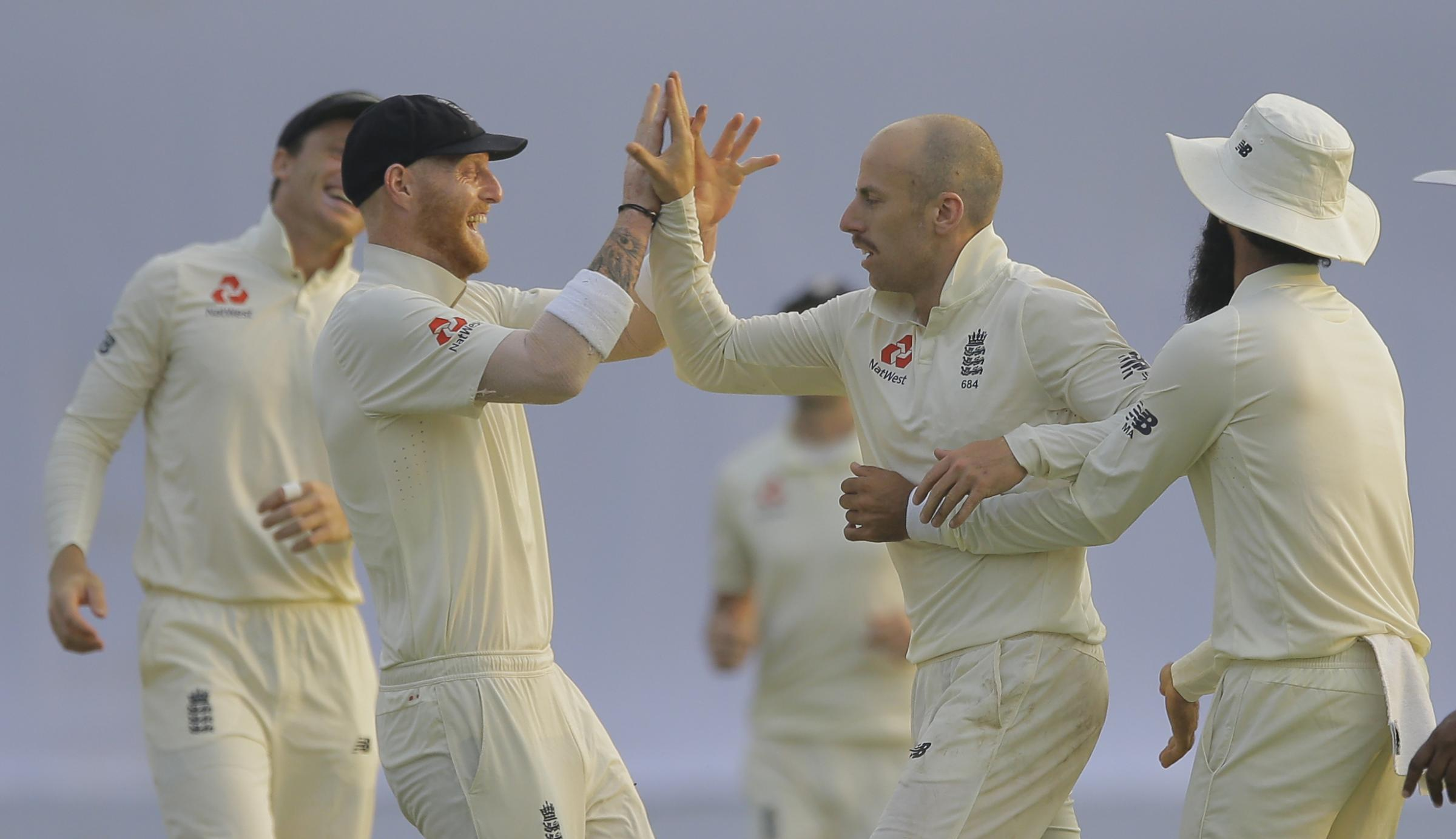 WICKET: Jack Leach celebrates with Ben Stokes (left) and Moeen Ali after dismissing Kaushal Silva. Pic: PA
