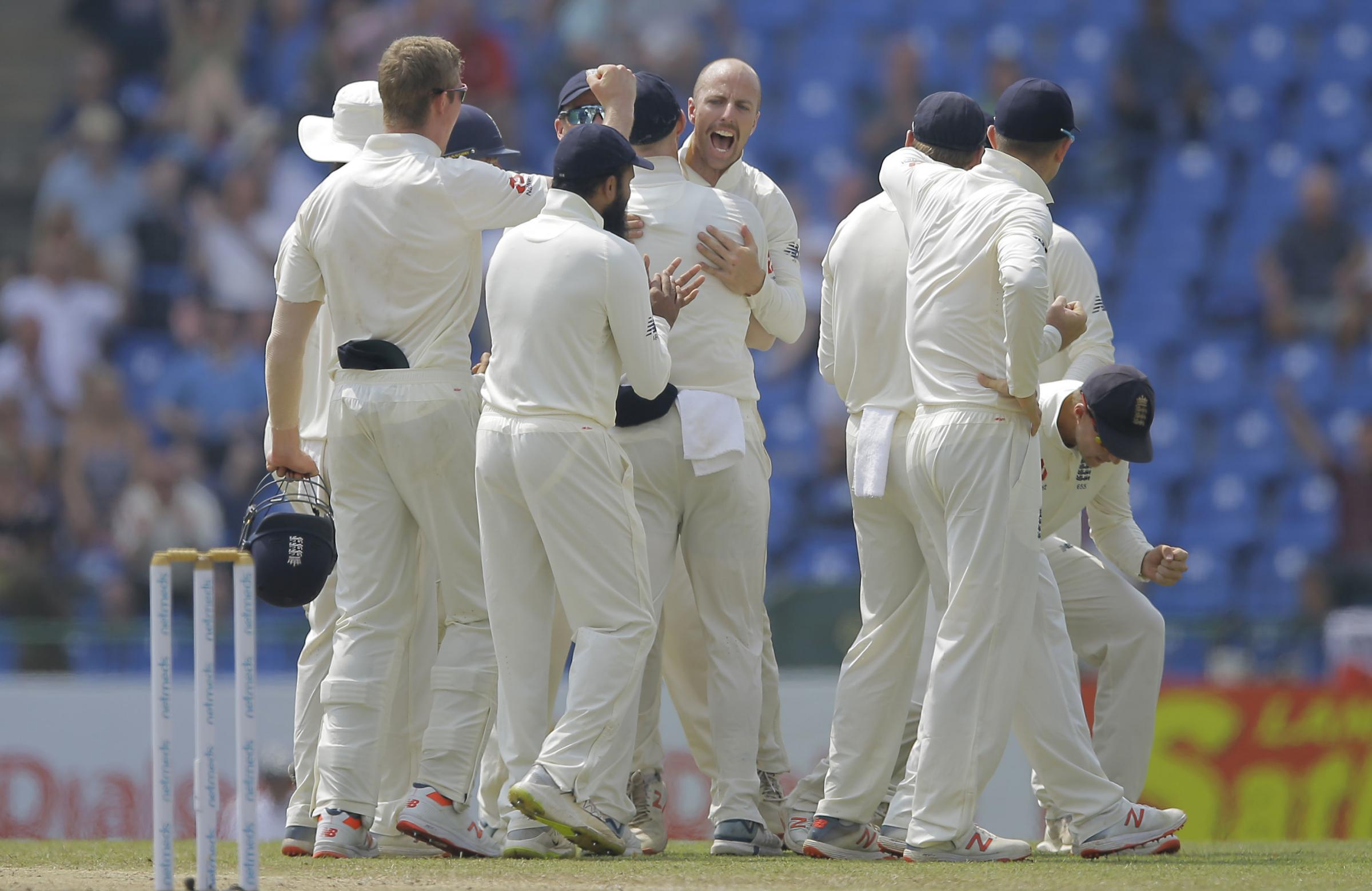KEY ROLE: England's Jack Leach, centre, celebrates along with team-mates after taking the wicket of Sri Lanka's Kusal Mendis. Pic: PA Wire