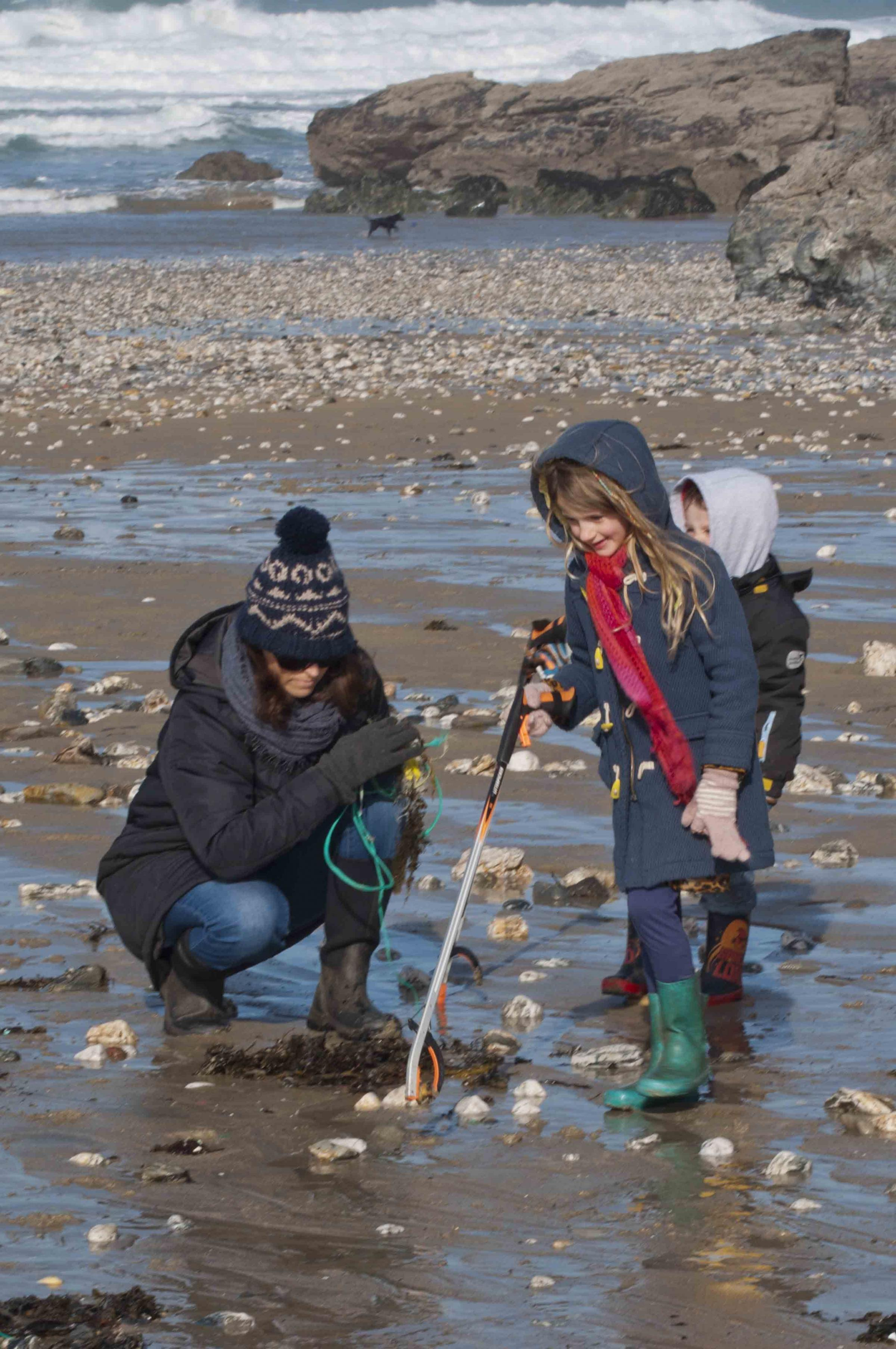 PROJECT: A family looks for marine litter during a Somerset's Brilliant Coast beach clean this year. Picture - Steve Lee