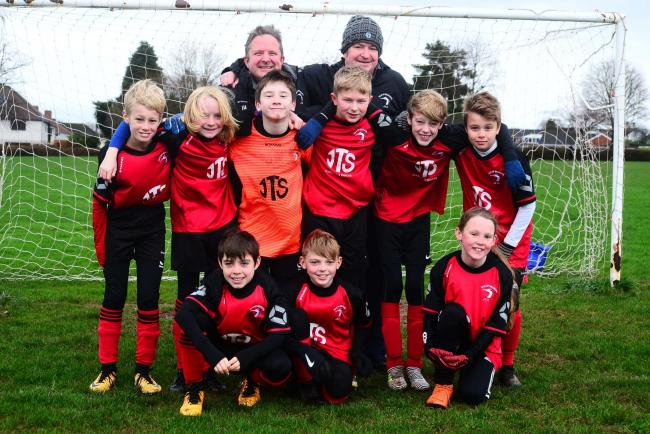 HURRICANES: Isle of Wedmore Under-12s, 5-2 winners at Galmington Dragons on Saturday. Pictured are: back row - coaches Jason Hann and Ian Monson; middle row - Ollie, Dylan, Hugo, Flether, Fin, Will; front row - Ellis, Dennis, Maddie.