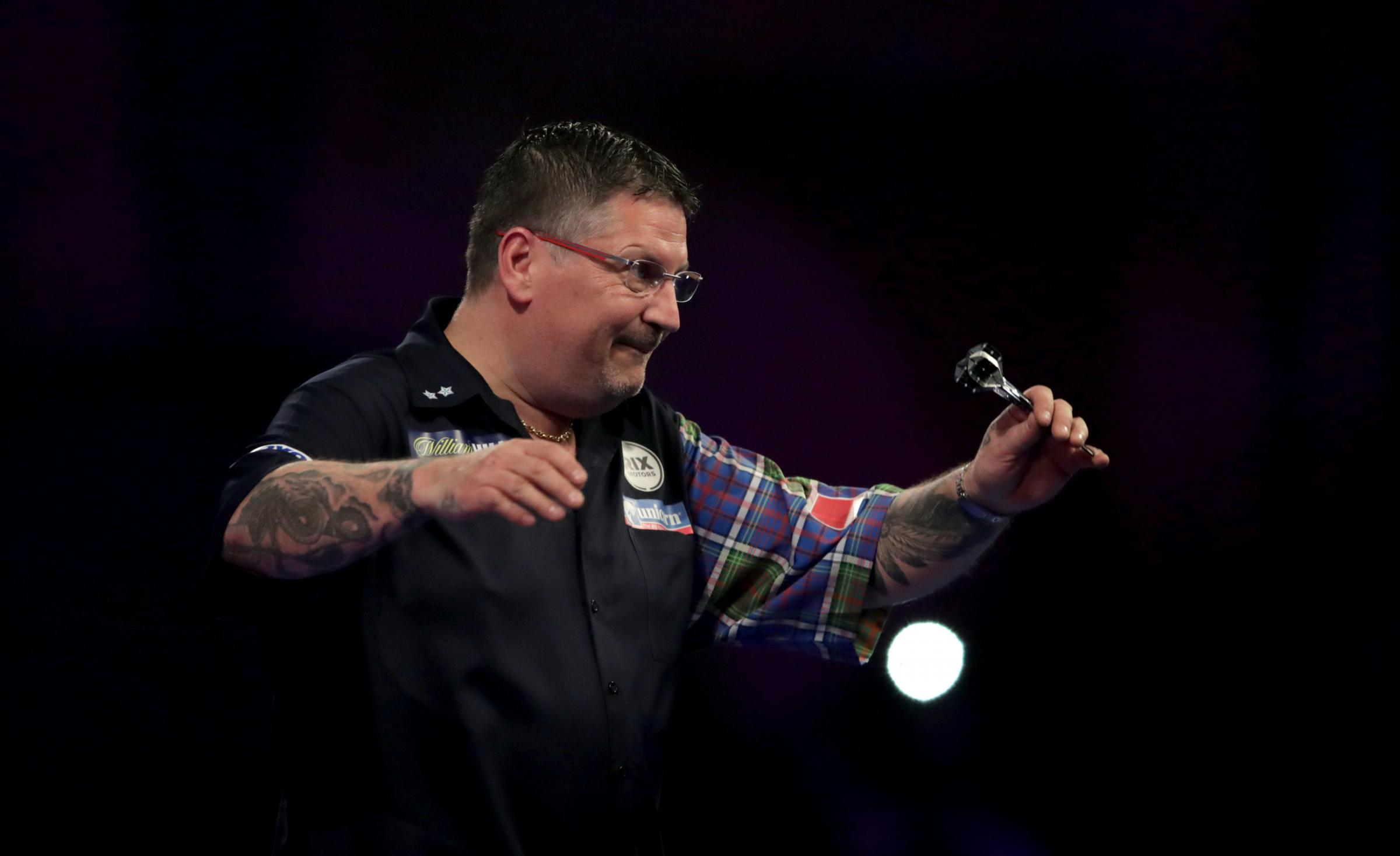 THROUGH: Gary Anderson survived a scare against Jermaine Wattimena