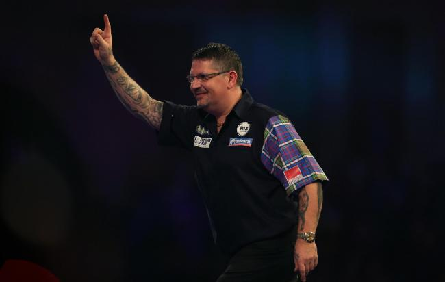 TRIUMPH: Gary Anderson celebrates winning his match against Chris Dobey. Pic: Steven Paston/PA Wire
