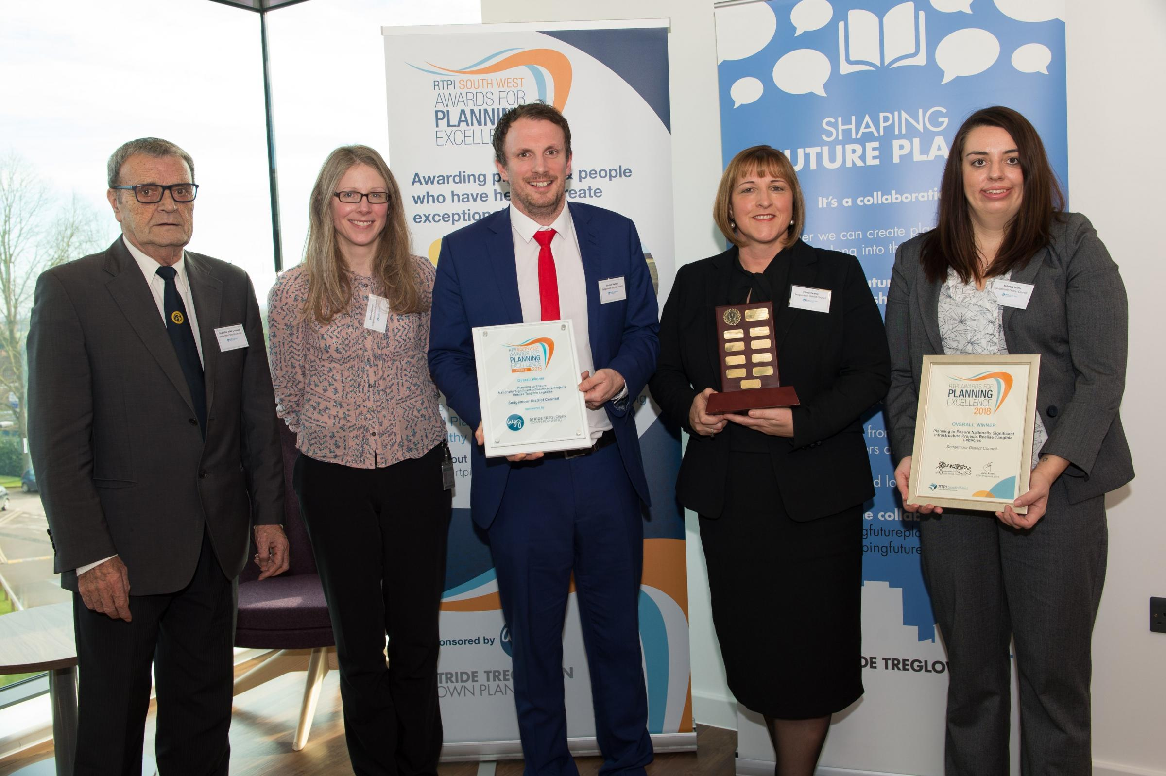 COLLECTING THE AWARD: Council Chairman, Mike Cresswell; Assistant Director Inward Investment and Growth, Claire Pearce; Principal Planning Officer HPC, Rebecca Miller; Principal Development Officer Infrastructure, Sam Harper and Major Projects Officer, Em