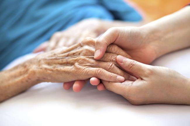 A generic photo of a woman holding an dementia sufferer's hands. See PA Feature TOPICAL Health Dementia. Picture credit should read: PA Photo/thinkstockphotos. WARNING: This picture must only be used to accompany PA Feature TOPICAL Health Dementia..