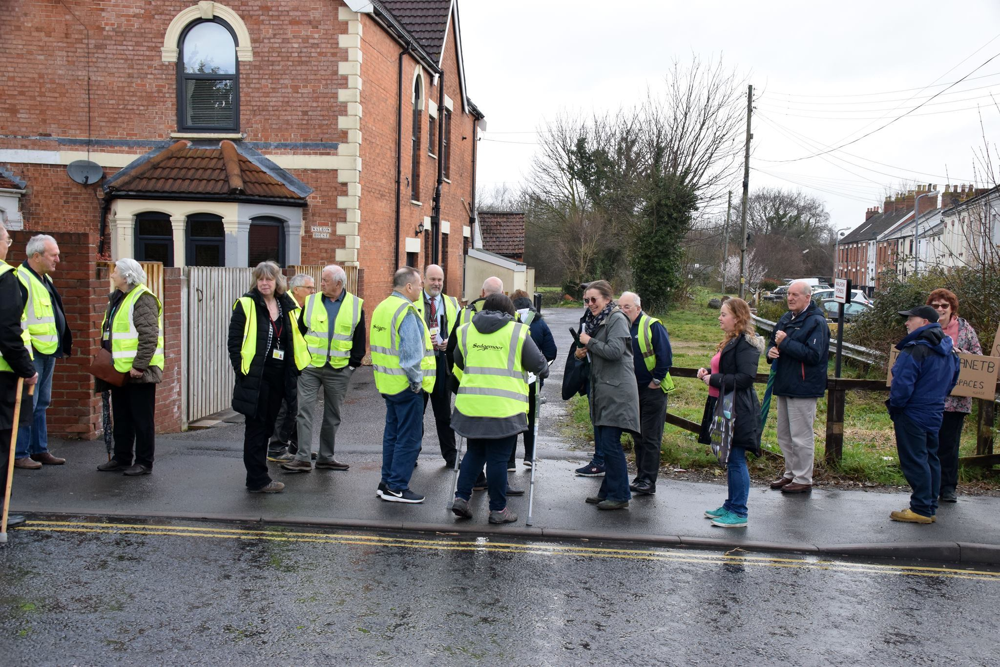 PROTEST: Protestors outside of the site in Walrow Road with members of Sedgemoor District Council's development committee. Picture - Mike Lang