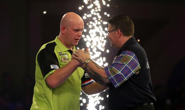 Michael van Gerwen shakes hands with Gary Anderson after the match during day fifteen of the William Hill World Darts Championships at Alexandra Palace, London. PRESS ASSOCIATION Photo. Picture date: Sunday December 30, 2018. Photo credit should read: Ste
