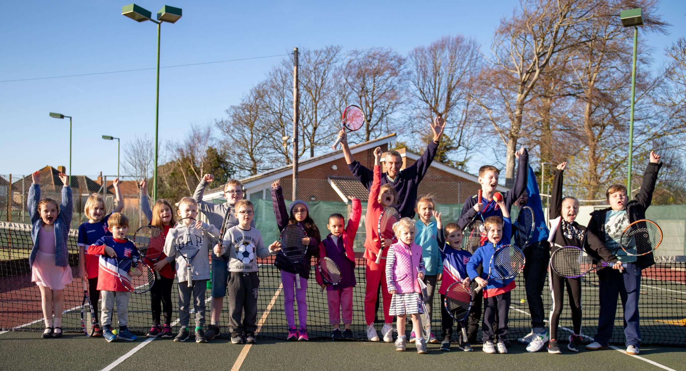 CHEERS: John Feaver (centre) at Avenue Tennis Club's PPS session. Pic: Darren Lloyd