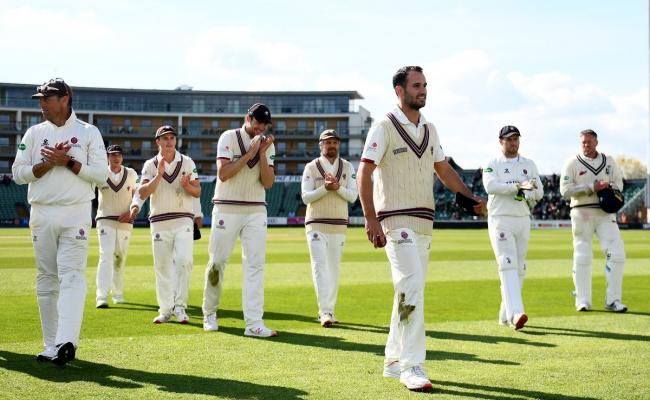 IN FORM: Lewis Gregory leads Somerset off after his match-winning 5-18 againts Kent. Pic: Alex Davidson/SCCC