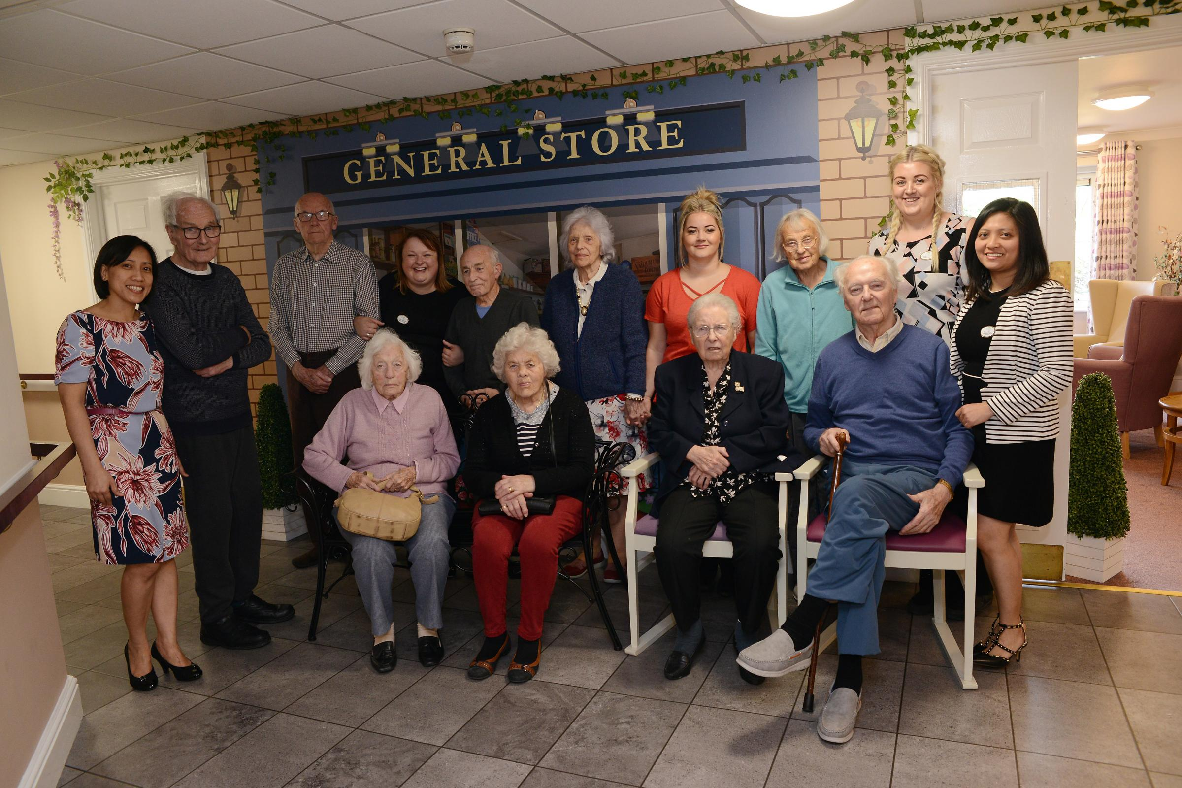 CELEBRATION: Residents and staff at Frith House celebrate the opening of the new household area