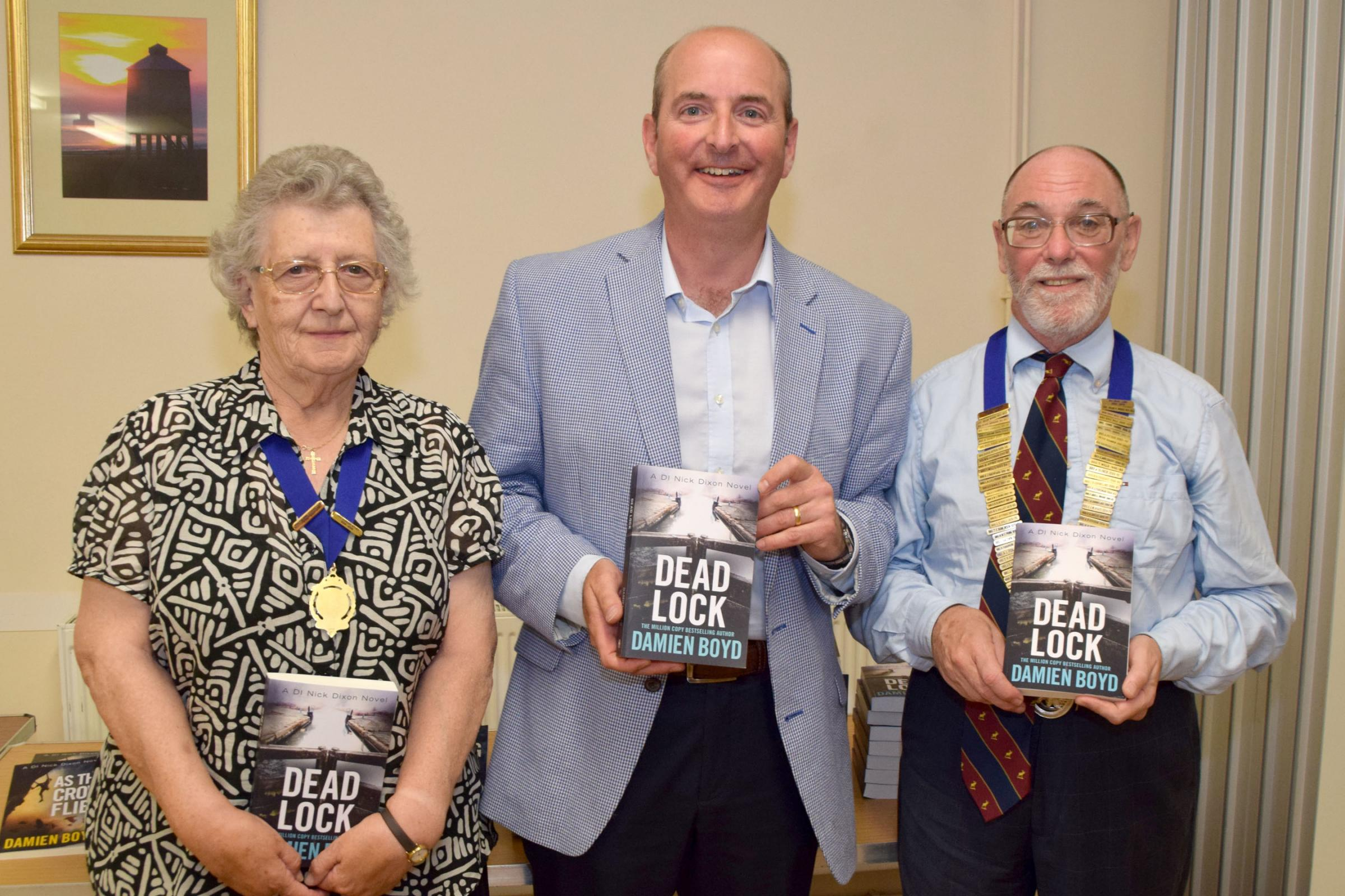 TALK: Author Damien Boyd with Pat Burge and Jim Dolan from Moose International. Credit - Mike Lang