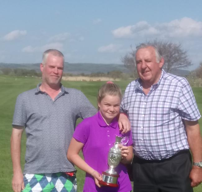 DELIGHT: Brean Golf Club president Richard House (right) with the winning duo of Steve and Millie Jones
