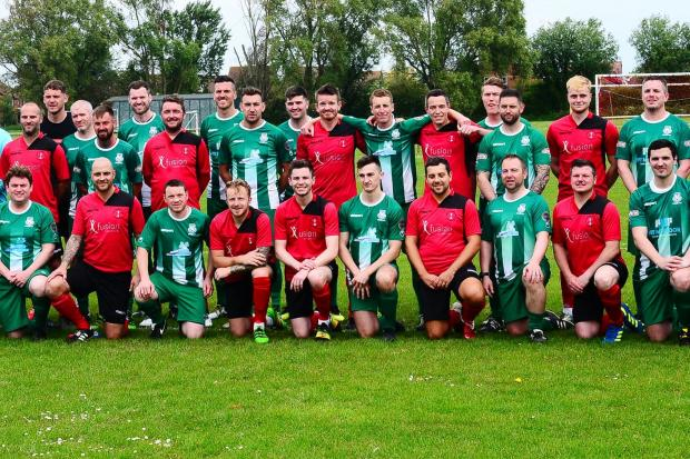 SQUADS: The John McErlain XI (green kit) and Luke Buckingham XI (red kit) players line up before the match. All pics: Steve Richardson